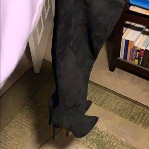 Black suede knee boots.